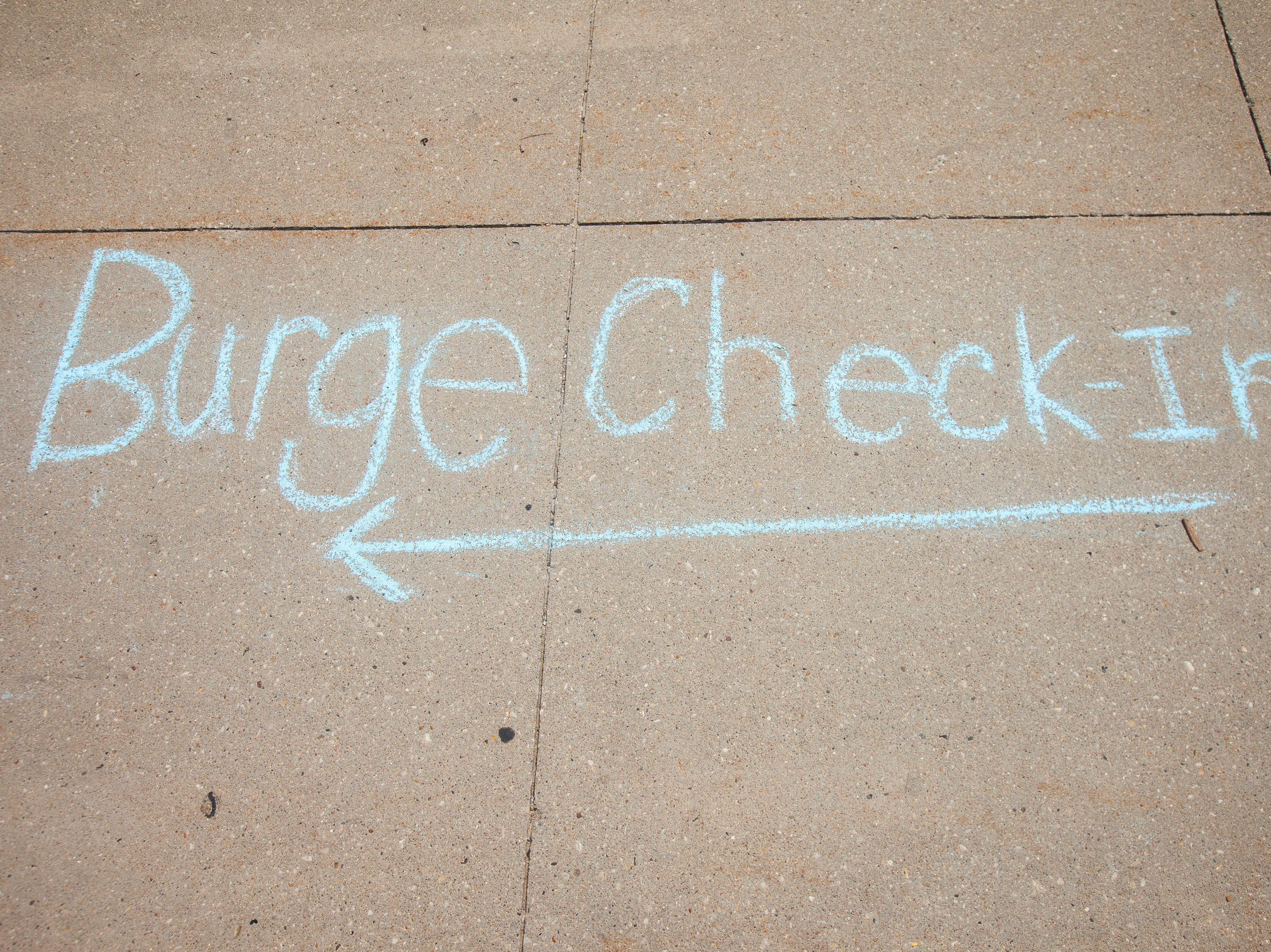 A sidewalk outside of Burge Residence Hall directs towards check-in during new student move-in on Tuesday, Aug. 14, 2018, on the University of Iowa campus in Iowa City. Tuesday was the first day for new students on campus to move into their residence halls.