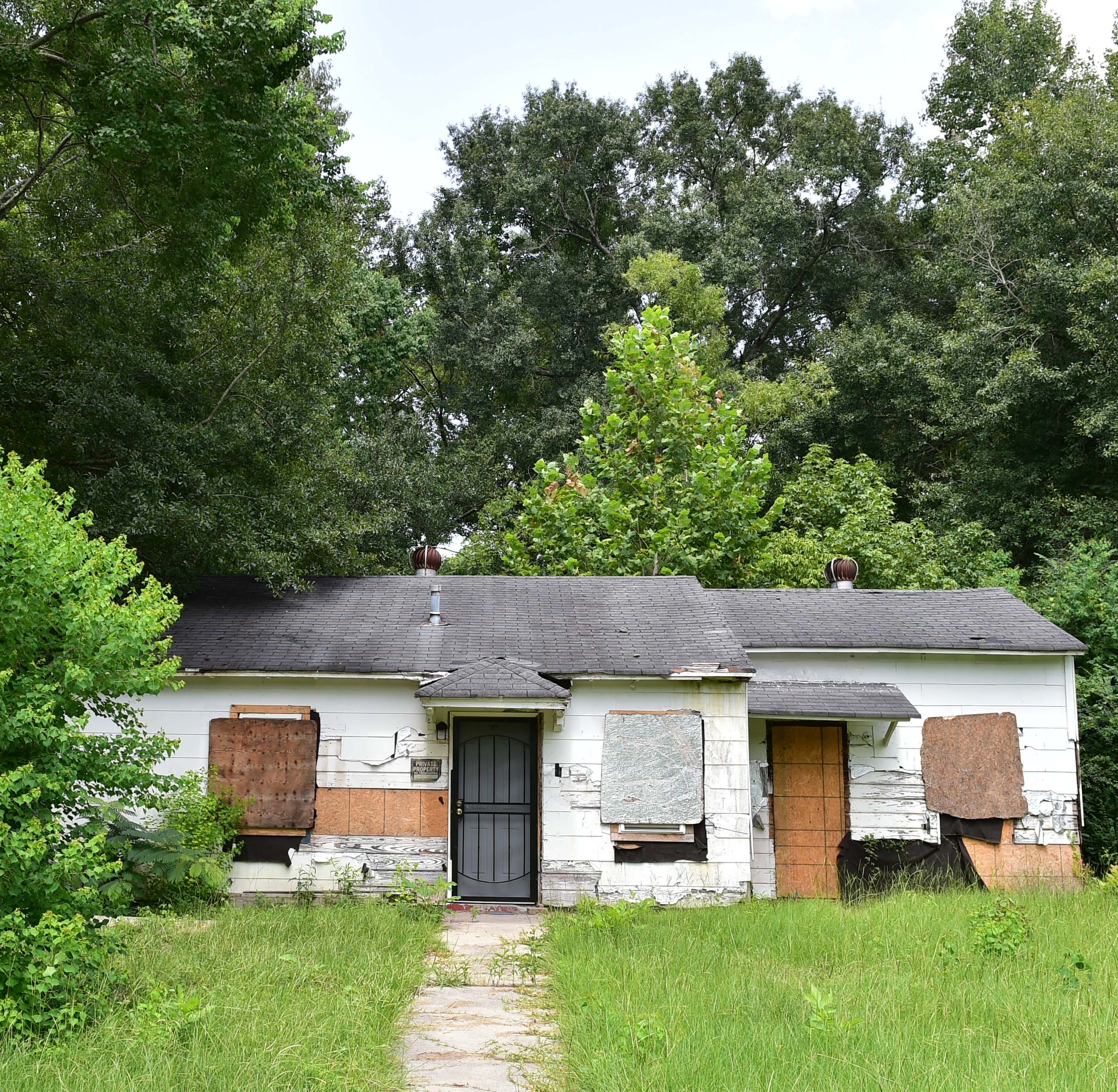 A home lies in disrepair is one of many spotting the neighborhood surrounding Viola E. Lake Elementary in Jackson. Tuesday, Aug. 14, 2018.