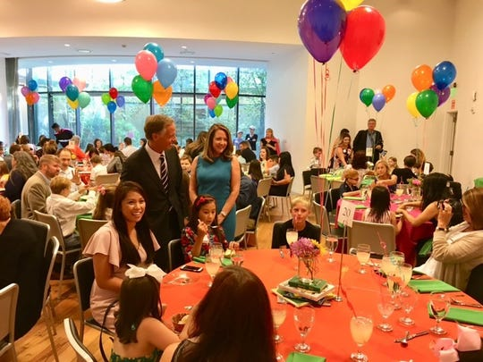 Tennessee Governor Bill Haslam and his wife Crissy greet 100 children selected from the Summer Reading Challenge during dinner on Sunday night.