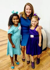 Isabella Hammond (left) and Anna Marie Wyatt take a picture with Tennessee First Lady Crissy Haslam.