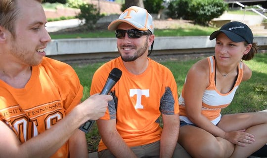 Vol Boy Kane Harris interviews two UT fans near Neyland Stadium prior to Fan Day on Aug. 5.