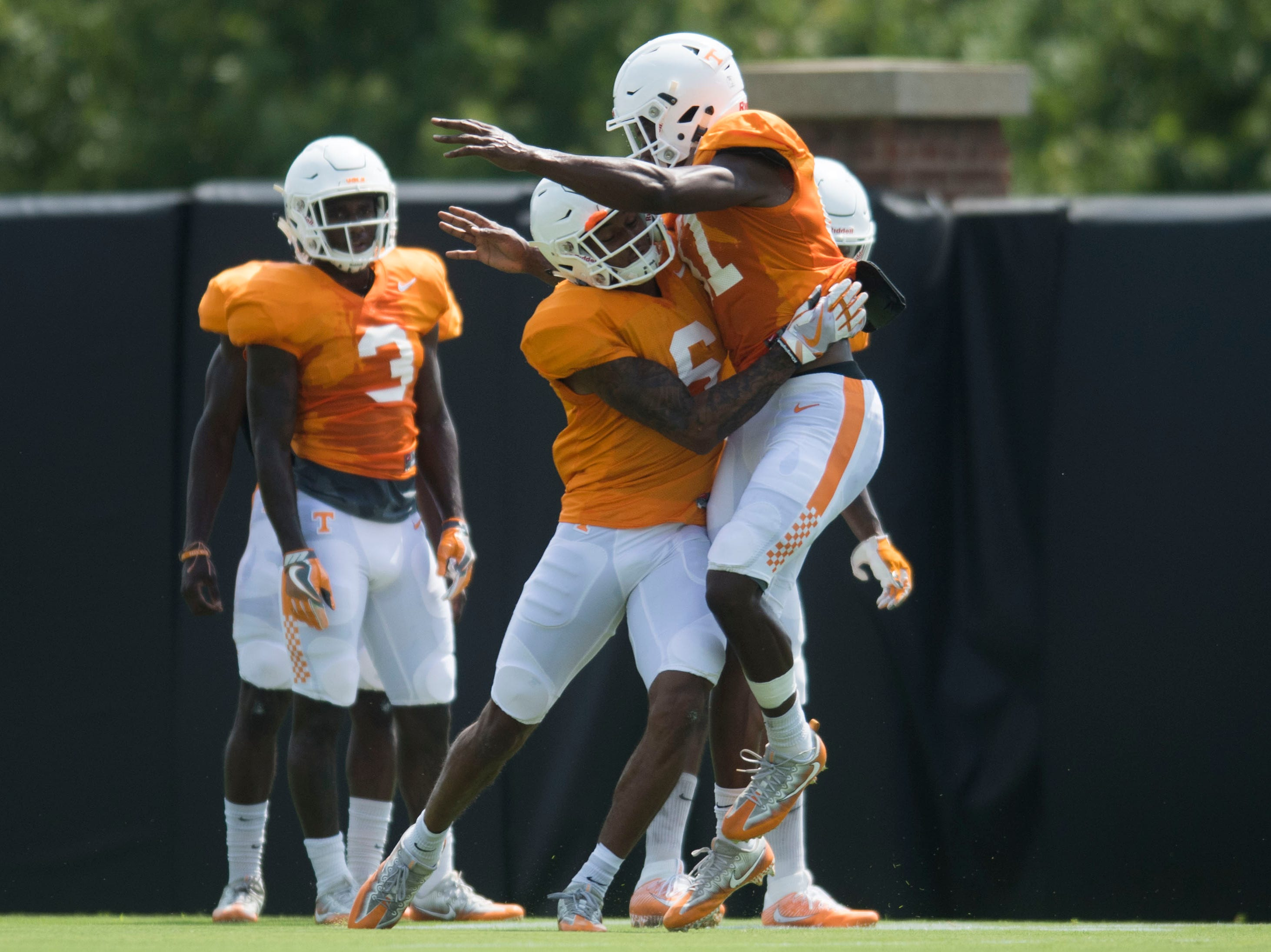 Tennessee defensive back/wide receiver Alontae Taylor (6) and Tennessee defensive back Kenneth George Jr. (41) participate in a  drill at preseason Vols football practice Tuesday, Aug. 14, 2018.