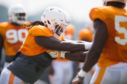 Tennessee defensive lineman Alexis Johnson (98) participates in a drill at preseason Vols football practice Tuesday, Aug. 14, 2018.