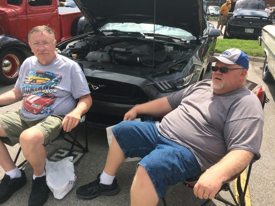 Jack Gillman, left, and his grandson Brian Arthur were planted in front of Jack's Mustang at the Travis Wegener Memorial Car Show.