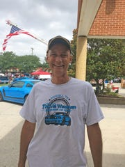 Dr. Don Wegener started the car show in honor of his son Travis, who was killed in 2014. The 2013 Mustang seen behind Wegener was Travis's.