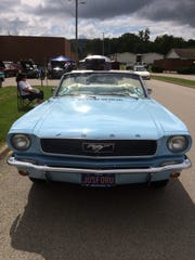 The JUSFORU license plate on a 1966 Mustang was one of many distinctive touches at the car show.