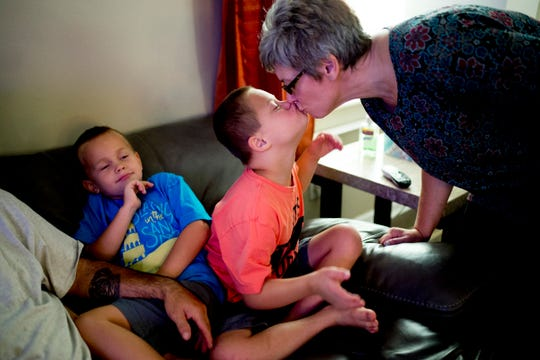 Caden gives a kiss to his mom, Stephanie Carmichael, at their home in East Knoxville on Saturday, August 11, 2018. The Carmichaels, who have adopted four children with Down syndrome, received a ramp free of charge built by Amramp of East Tennessee.