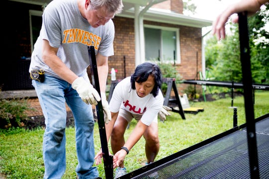 Zerlina Waldrop and Scott Applegate help put together a ramp at the Carmichael home in East Knoxville on Saturday, August 11, 2018. The Carmichaels, who have adopted four children with Down syndrome, received a ramp free of charge built by Amramp of East Tennessee.