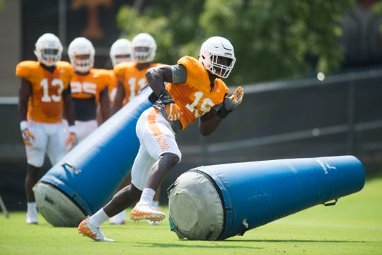 Tennessee linebacker Darrell Taylor (19) participates in a drill at preseason Vols football practice Tuesday, Aug. 14, 2018.