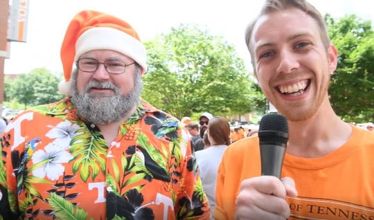 Vol Boy Kane Harris, right, speaks with a fan known as Santa Vol outside Neyland Stadium at UT Fan Day on Aug. 5.