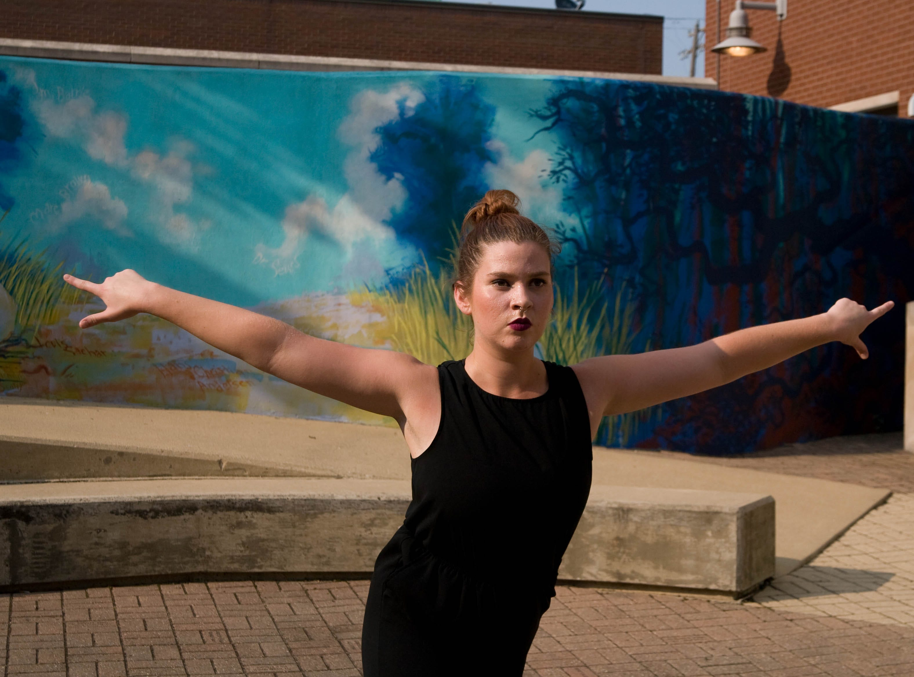 "Sara Satterly works in preparation for her public performance of ""April is the Cruelest Month"" A dance work in 8 parts on August 24th and 25th at the West Lafayette public library."