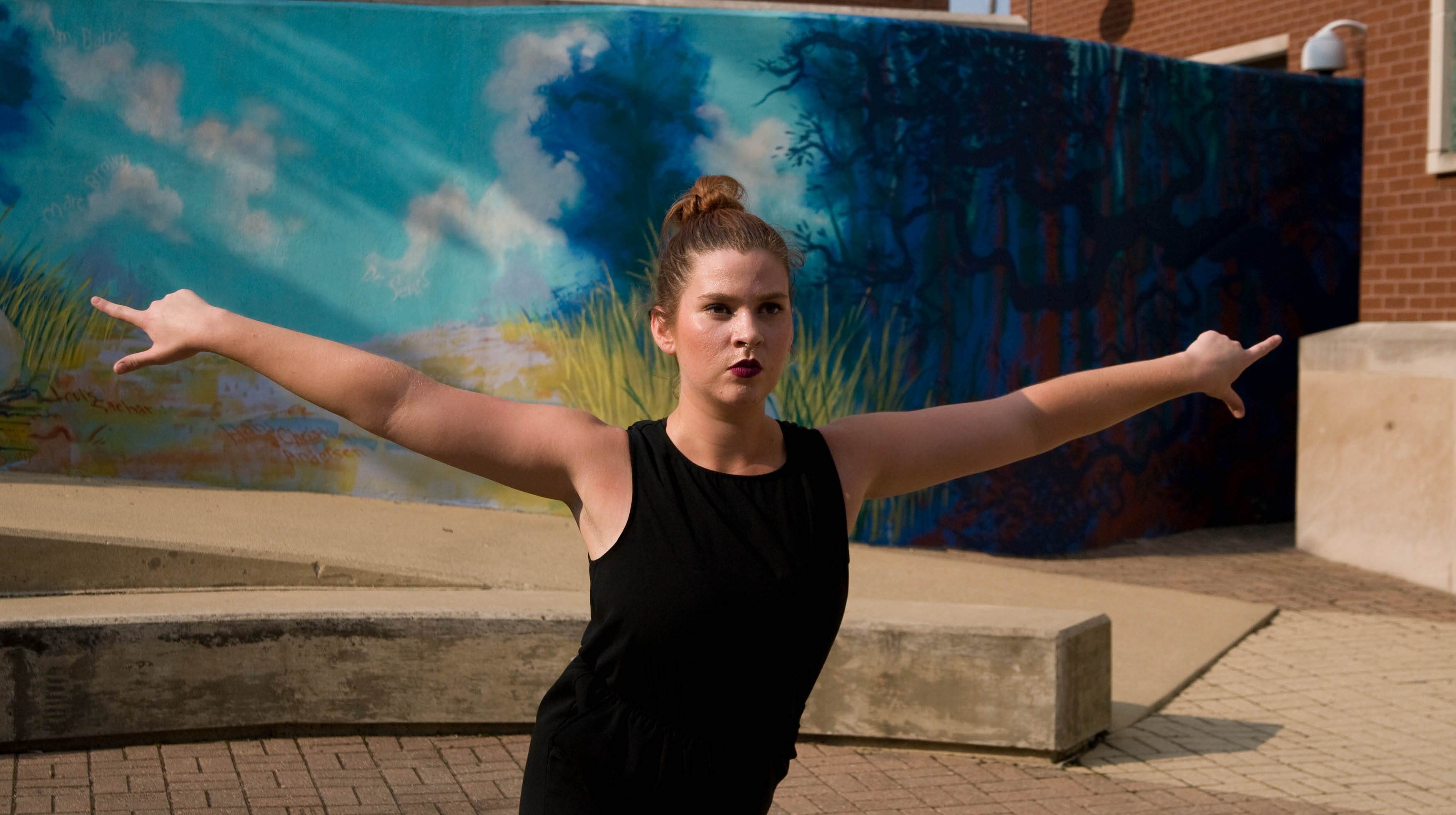 """Sara Satterly works in preparation for her public performance of """"April is the Cruelest Month"""" A dance work in 8 parts on August 24th and 25th at the West Lafayette public library."""