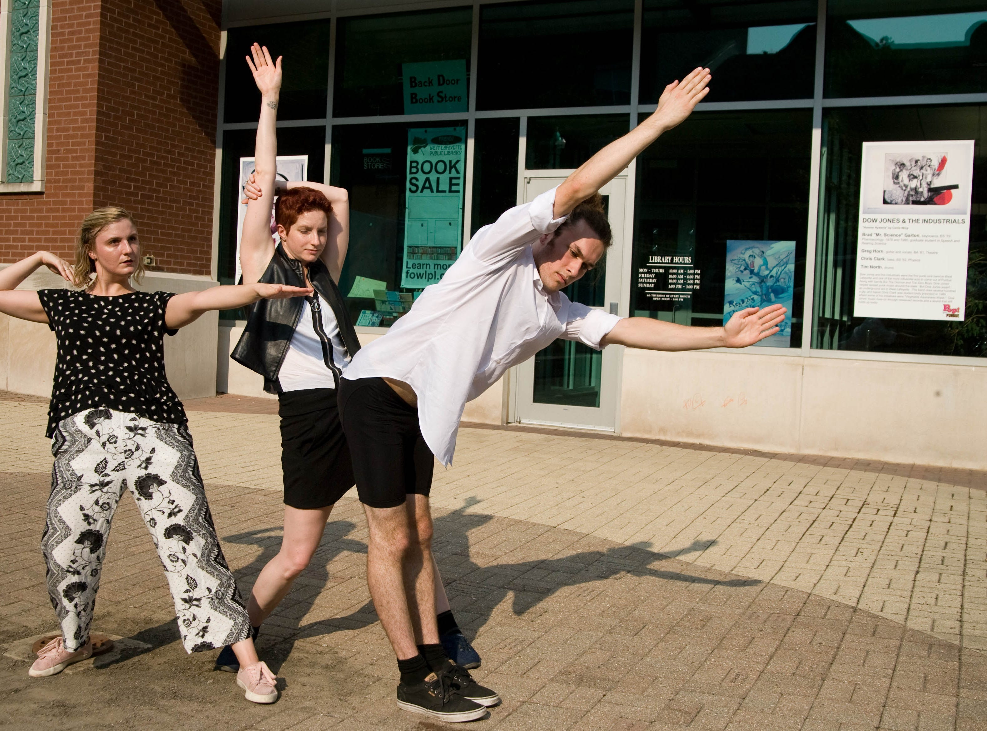 "Carrie Grant, Deborah Kull and Arlo Eitzer dance in preparation for their public performance of ""April is the Cruelest Month"" A dance work in 8 parts on August 24th and 25th at the West Lafayette public library."