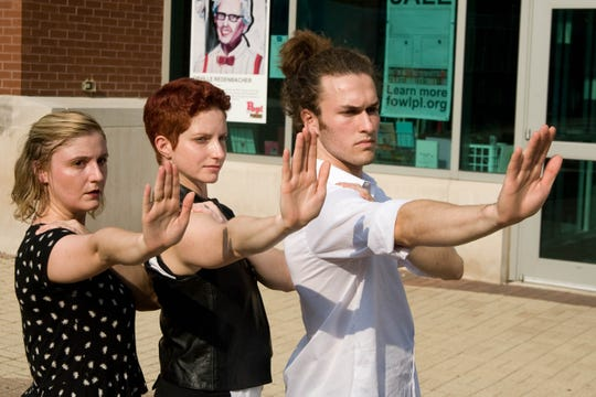 """Carrie Grant, Deborah Kull and Arlo Eitzer dance in preparation for their public performance of """"April is the Cruelest Month"""" A dance work in 8 parts on August 24th and 25th at the West Lafayette public library."""