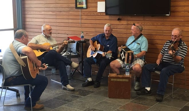 Stanley Lee, second from left, plays with musicians during the July jam session at the St. Landry Parish Visitor Center in Opelousas.