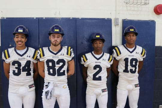 Carencro's Hard Hat Award winners include Chad Dupuis (34), Blake Lacombe (82), Artrell Marks (2) and Nick Eagins.