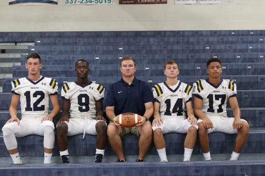 Carencro's quarterbacks, pictured here with assistant coach Thomas Tillery, include Austen Breaux (12), Travion Faulk (9), Lleyton Leblanc (14) and Zavier Randall (17).