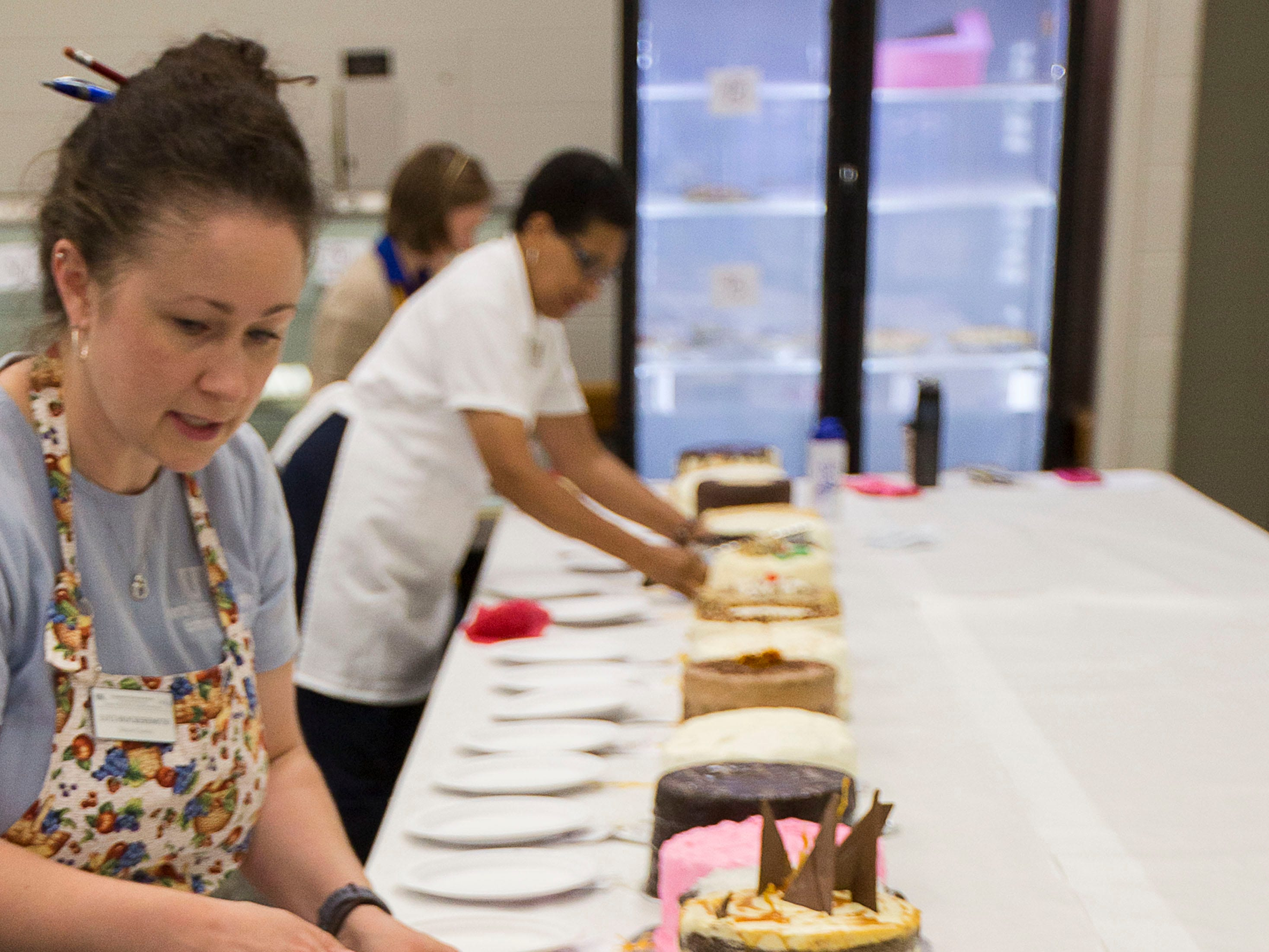 """Jeanette Chapman smells the Choco Mint cake during the judging of """"Favorite Cake"""" at the Kentucky State Fair on Tuesday, August 14, 2018."""