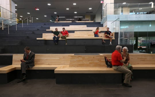 These benches inside the new Belknap Academic Building were created from wood reclaimed from the old Crawford gym.