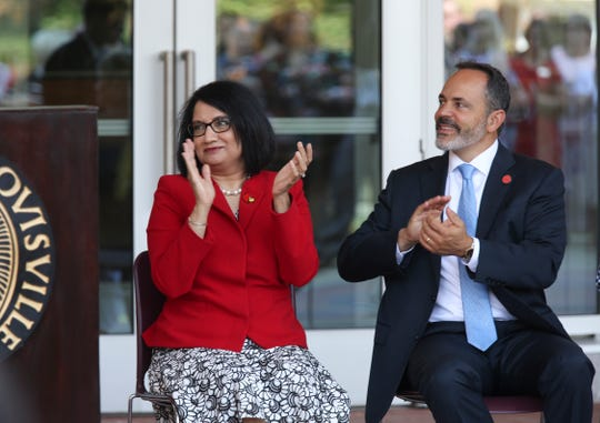 University of Louisville President Neeli Bendapudi, left, and Gov. Matt Bevin applauded as a student spoke during the unveiling of the new Belknap Academic Building on campus.