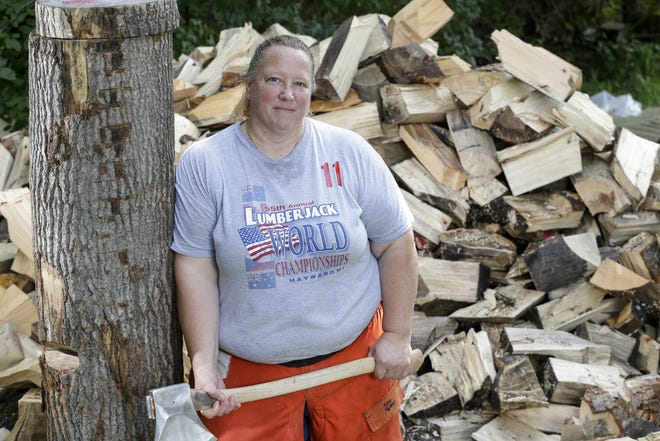 Timbersports athlete Nancy Zalewski poses for a picture where she trains outside her home Aug. 9 in Manitowoc. Zalewski recently took third place at the Stihl Timbersports Women's Division Championship in Milwaukee.