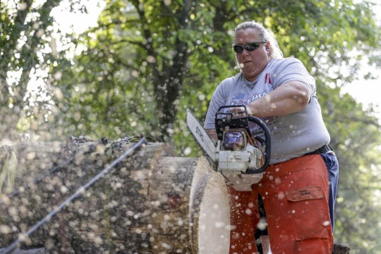 Nancy Zalewski practices her stock saw for an upcoming competition Aug. 9 in Manitowoc.