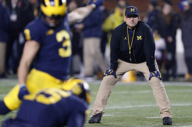 Michigan coach Jim Harbaugh is getting some heat because of his 1-5 record against rivals Ohio State and Michigan State