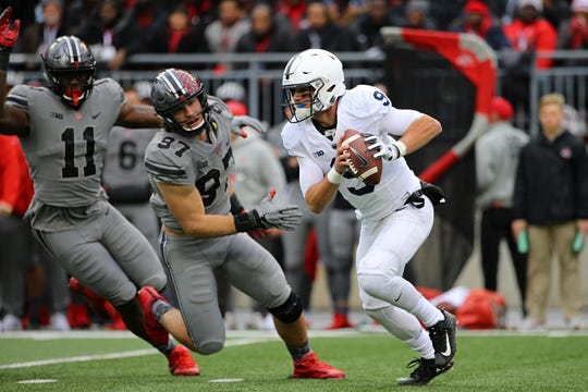 Penn State quarterback Trace McSorley tries to elude pressure from Ohio State defensive end Nick Bosa during last year's showdown in Columbus.
