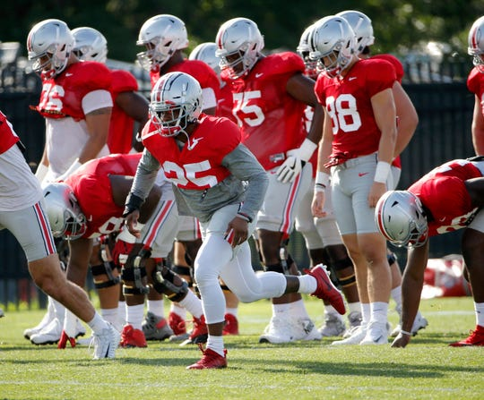 Ohio State tailback Mike Weber (25) participates in warmups during a practice earlier this month.