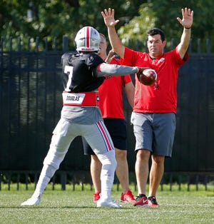 Ohio State offensive coordinator/quarterbacks coach Ryan Day watches quarterback Dwayne Haskins during a drill in training camp