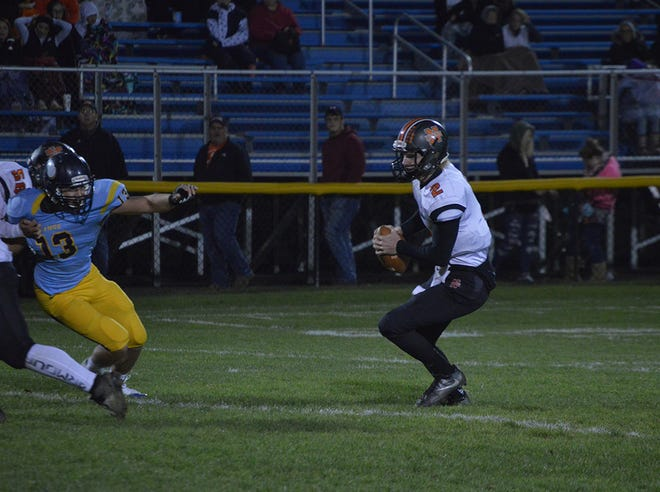 North Union quarterback Anthony Padovano fends off the rush by the River Valley defense last season. Padovano returns after throwing for 759 yards in 2017.