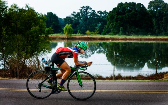 """I like to push myself. I like hurting,"" local triathlete Laura Mathews says."