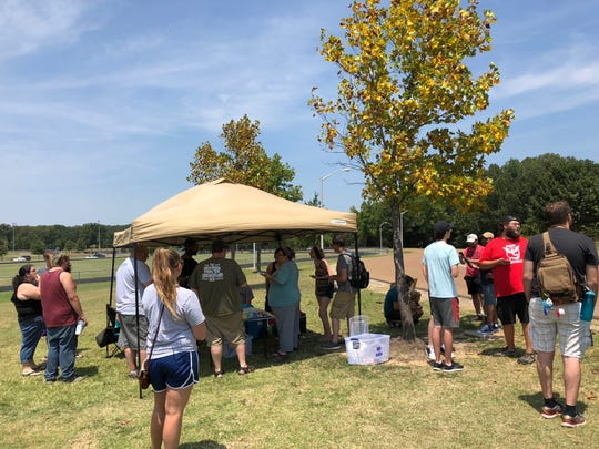 """Pokemon Go"" players gather at Olive Branch City Park just before the start of the game's August Community Day."
