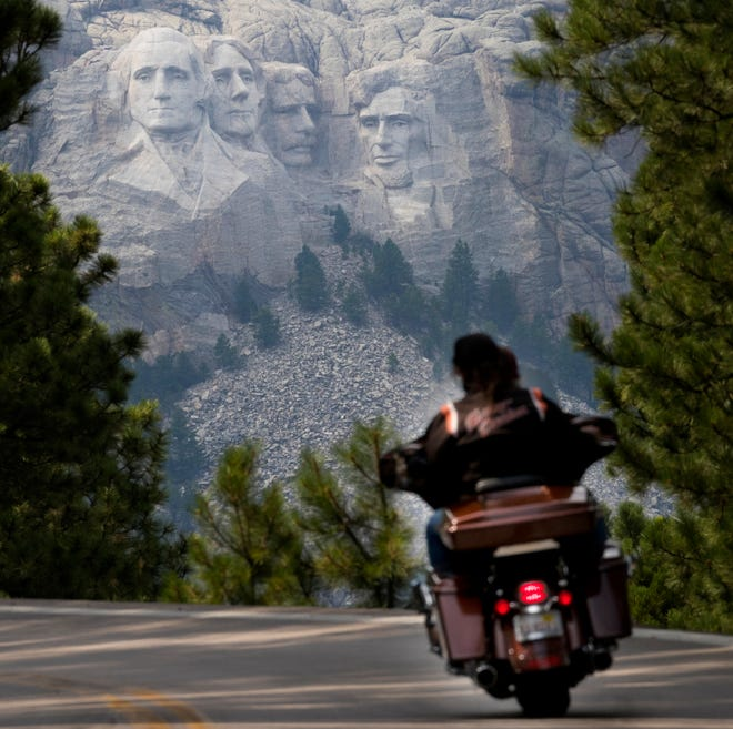 A Harley-Davidson motorcycle exits the Scovel Jophnson Tunnel on Iron Mountain near Mount Rushmore on Aug. 9, during the 78th Sturgis Motorcycle Rally.