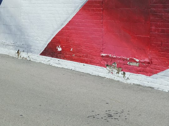Damage to the mural by cars backing into it. The American Legion Post 27 building is over 100 years old and in need of multiple repairs.