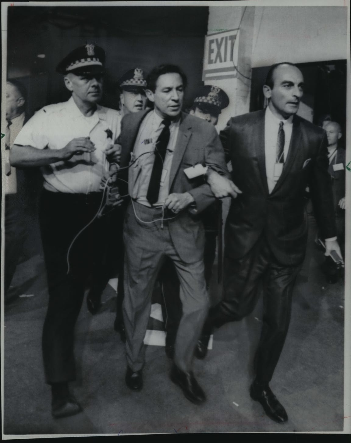 Chicago police escort CBS reporter Mike Wallace off the floor of the 1968 Democratic National Convention on Aug, 28, 1968.