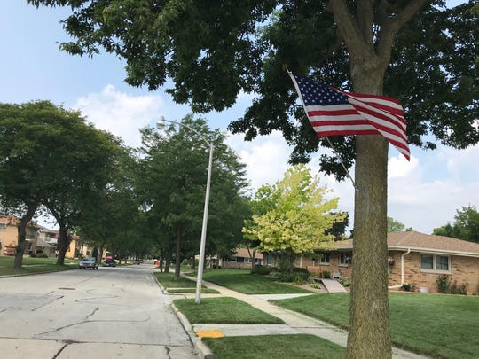 One flag at 72nd Street is the only survivor of an avenue of American flags that was most dense more than a block west, where the blue parked car is.