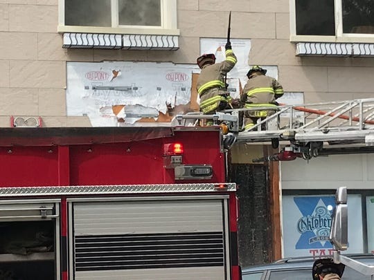 Firefighting crews work on the exterior of Spring City Wine House, 336 W. Main St., following a fire in downtown Waukesha.