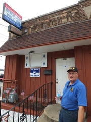 Ray Grabowski, the post commander, stands in front of American Legion Post 27 at 920 Monroe Avenue in South Milwaukee. The 100-year-old building is falling apart and the Legion needs funding for repair.