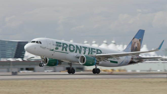 A Frontier Airlines jet is shown at Denver International Airport.