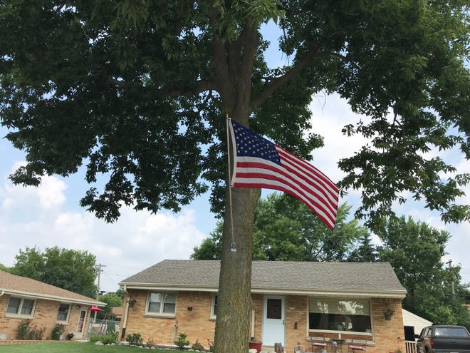 The only surviving Bennett Avenue flag flies in front of a home in Milwaukee at 72nd Street. West Allis took down the other approximately 16 flags that made almost an avenue of flags, mainly concentrated a couple of blocks west of 72nd Street.