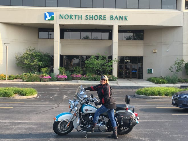 Lisa Starbuck often rides her Harley to her job at North Shore Bank in Brookfield.