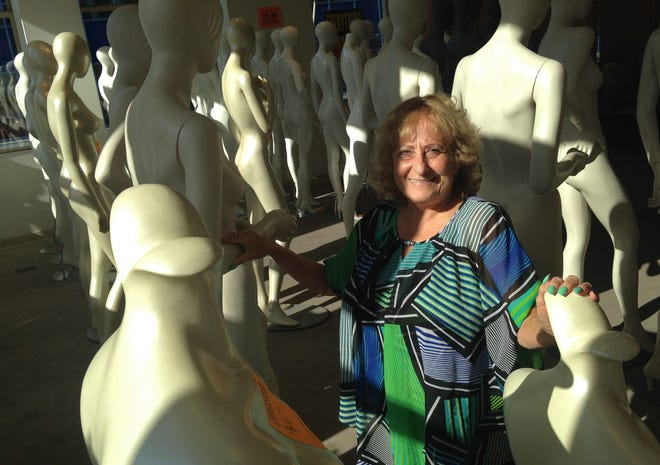 Mary Fraundorf mingles with the mannequins on the second level of Boston Store at the Shops of Grand Avenue mall. She used to work at the downtown location, which is closing along with other department stores of the bankrupt Bon-Ton Stores Inc. chain. The mannequins and other fixtures are for sale along with the remaining merchandise.
