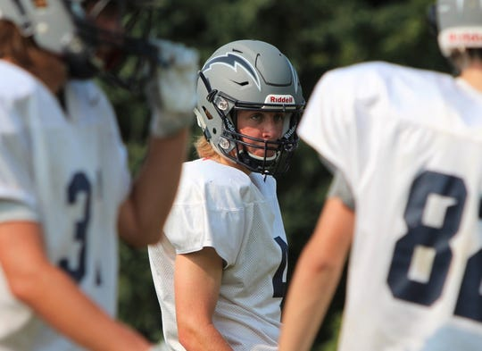 Lake Country Lutheran quarterback Ethan Wilkins looks on between drills during practice on August 13.