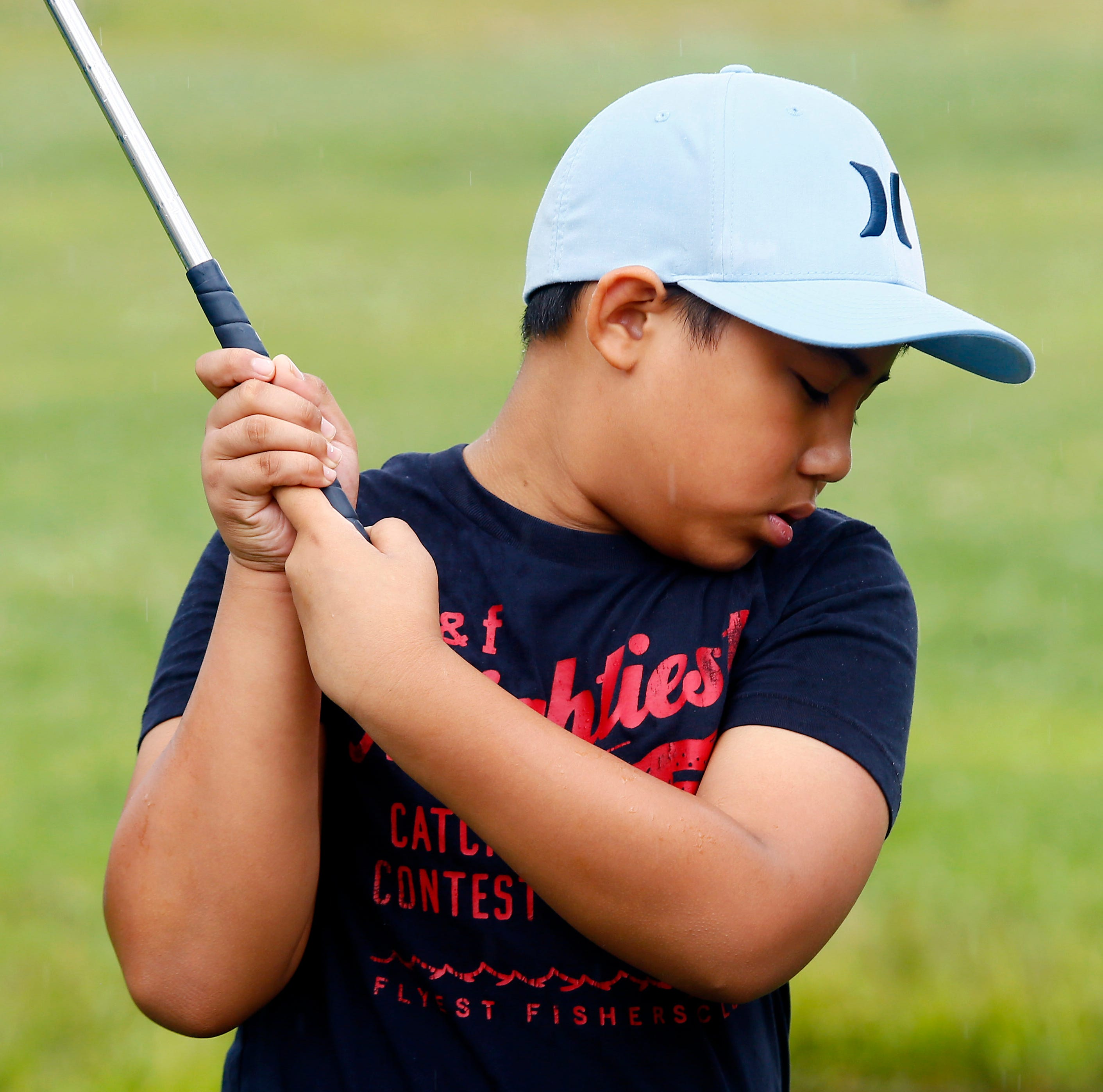 Rain can't dampen enthusiasm at Kids2Kids golf program