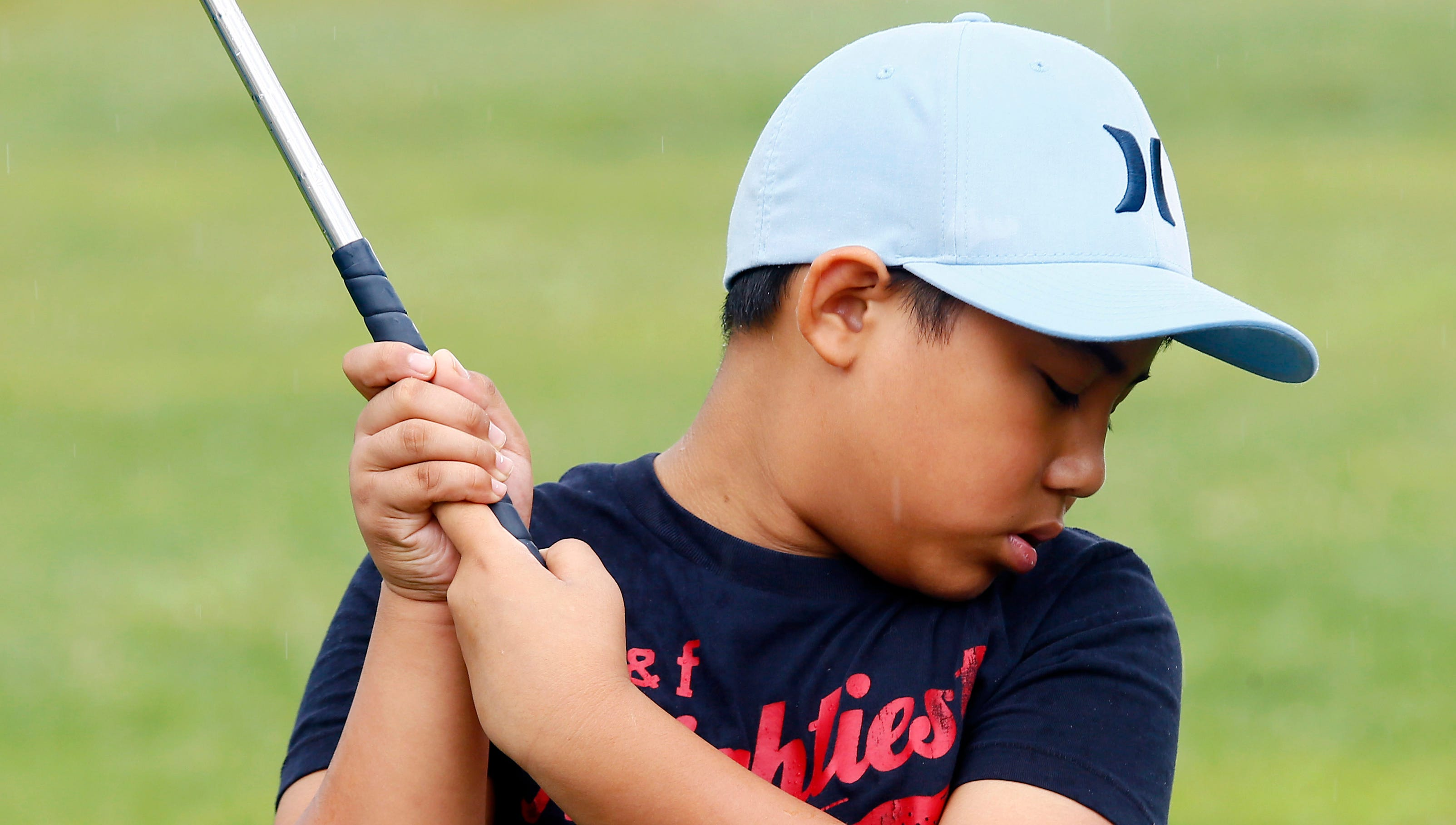 Rain can't dampen enthusiasm at Kids2Kids golf program
