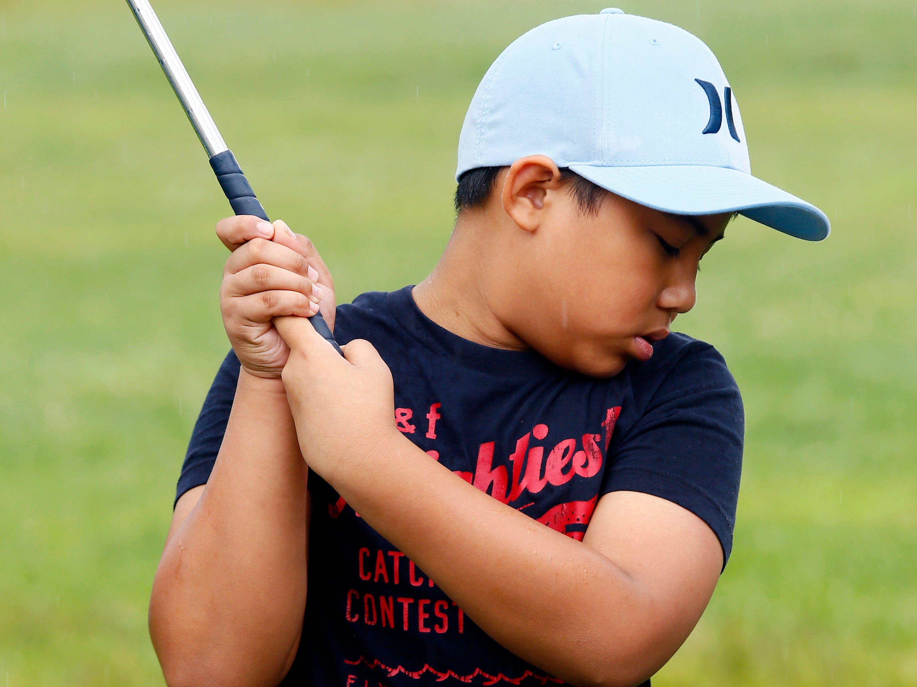 Joaquin Magracia, 9, of Parsippany drives the ball during Kids2Kids' summer golf program at Essex Golf Center. August 14, 2017, Roseland, NJ.