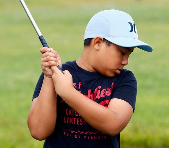 Joaquin Magracia, 9, of Parsippany drives the ball during Kids2Kids' summer golf program at Essex Golf Center. August 14, 2017, Roseland, NJ.
