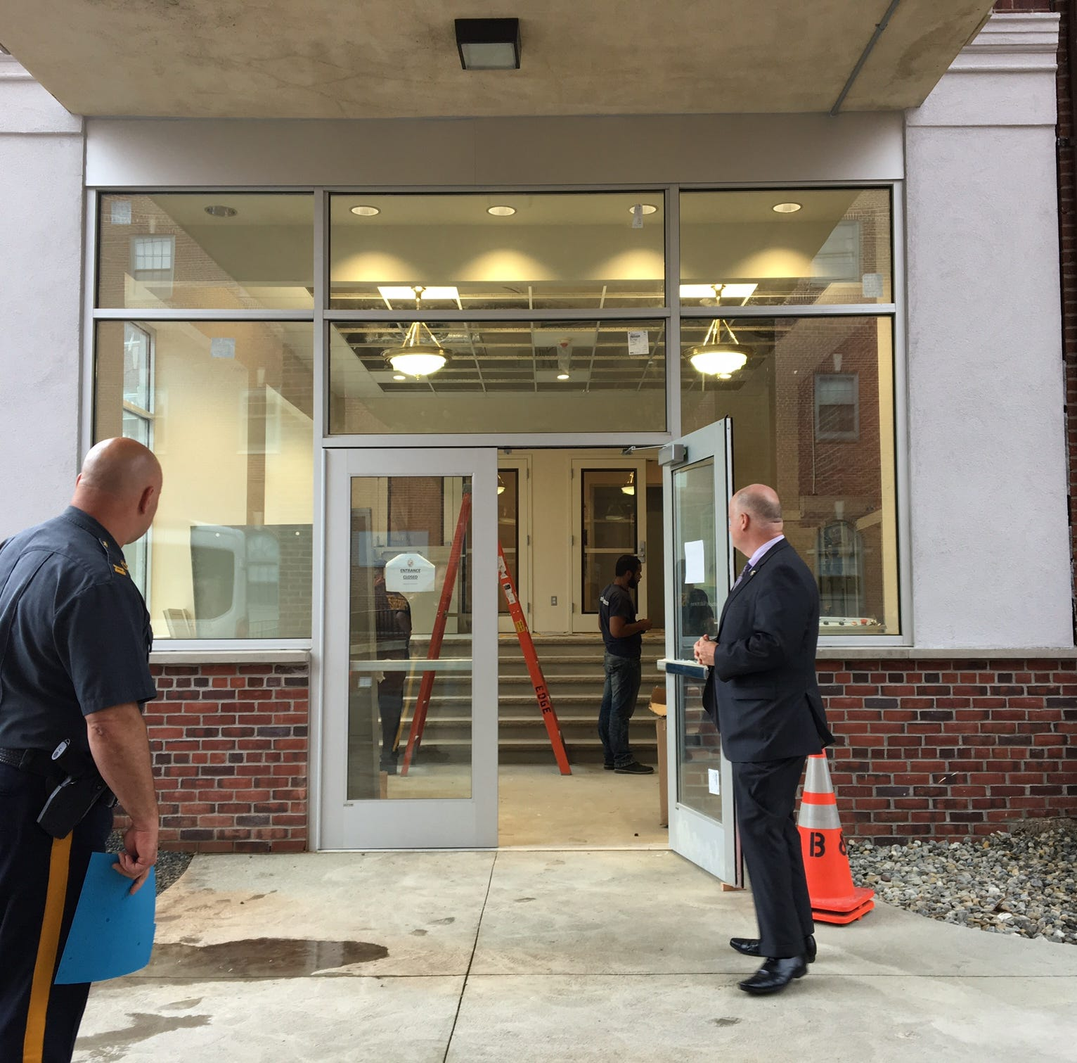 Morris County Sheriff James Gannon, R, and Capt. Gerald Pennino check the new entrance to the county courthouse, expected to open in about one week