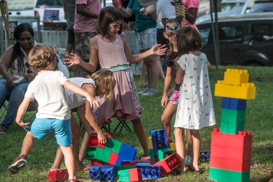 Children were having fun with giant building blocks. Shindig, a free concert and outdoor gathering that was also a fundraiser for Child Protect, Children's Advocacy Center, was held July 29, 2018, at Montgomery's Winter Place in Historic Cottage Hill.